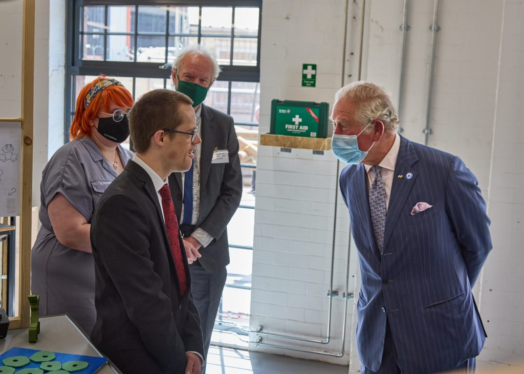 HRH Prince Charles meets a young artist called Jack at Daimler